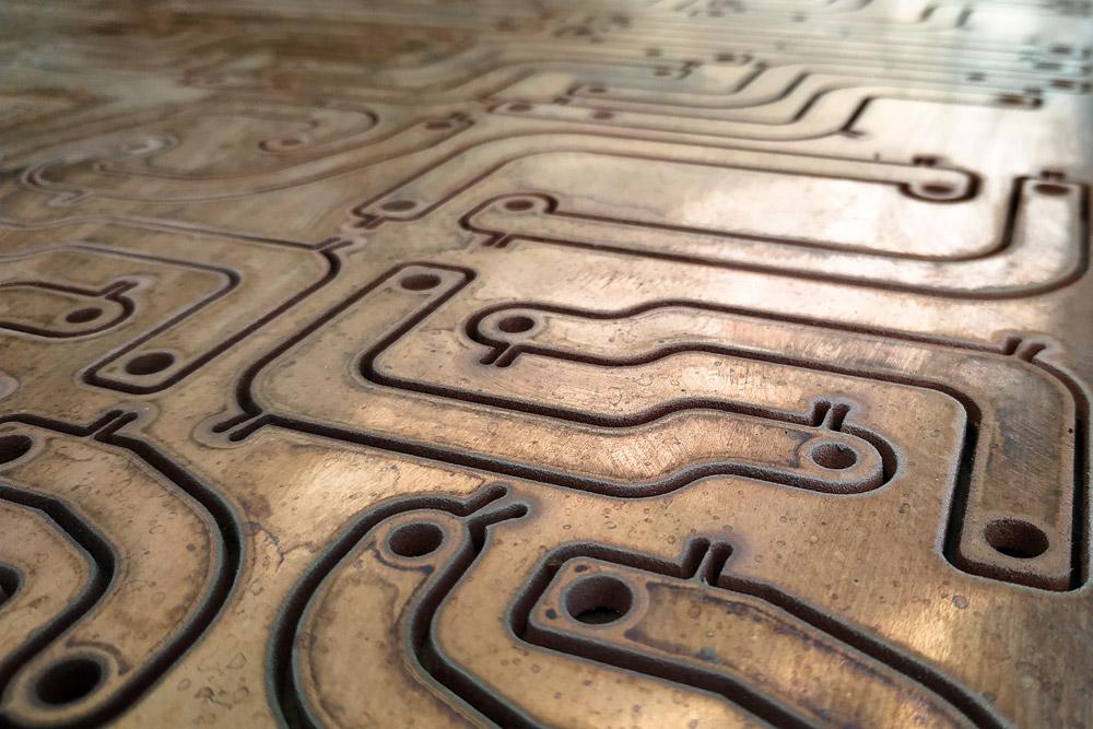 shapes cut into steel by waterjet machine